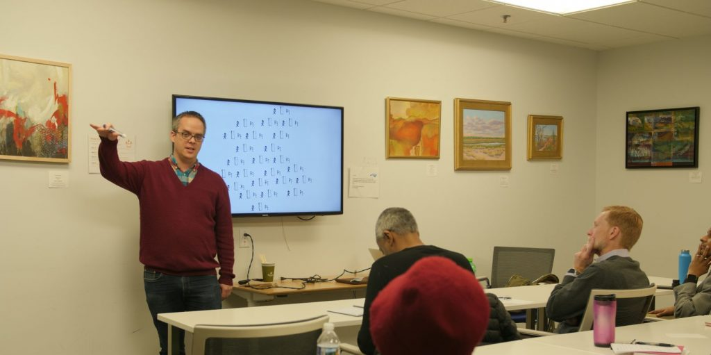 A picture of Chris Lysy teaching a workshop.